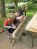 This family group helped so much on the Picnic Bench by Jeremy Turner, Sculpture, Wood